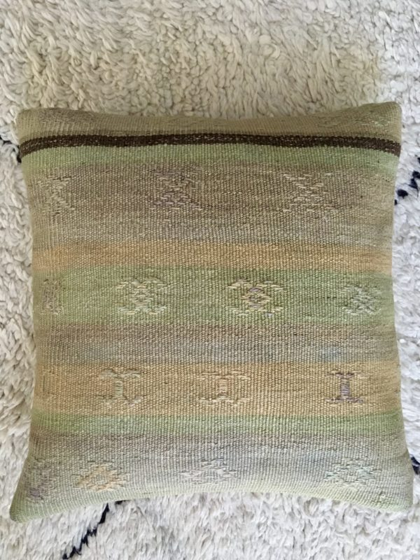square wool kilim cushion with brown and green stripes and patterns