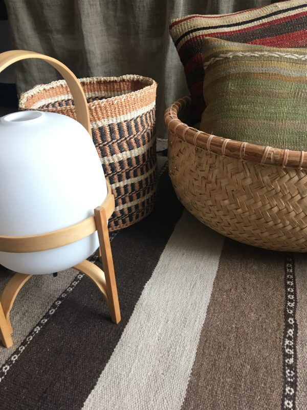 Turkish pillow #4 and kilim pillow #3 with a bamboo basket from Indonesia with a Kenyan sisal basket #17 with a table lamp santacole