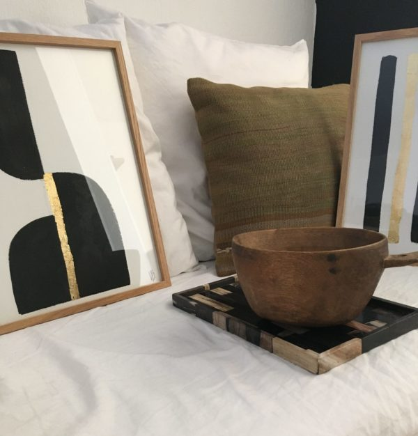 Indian ink #1 and #2 with a green kilim cushion and the antique oak milk jar on a linen white ghost umchair