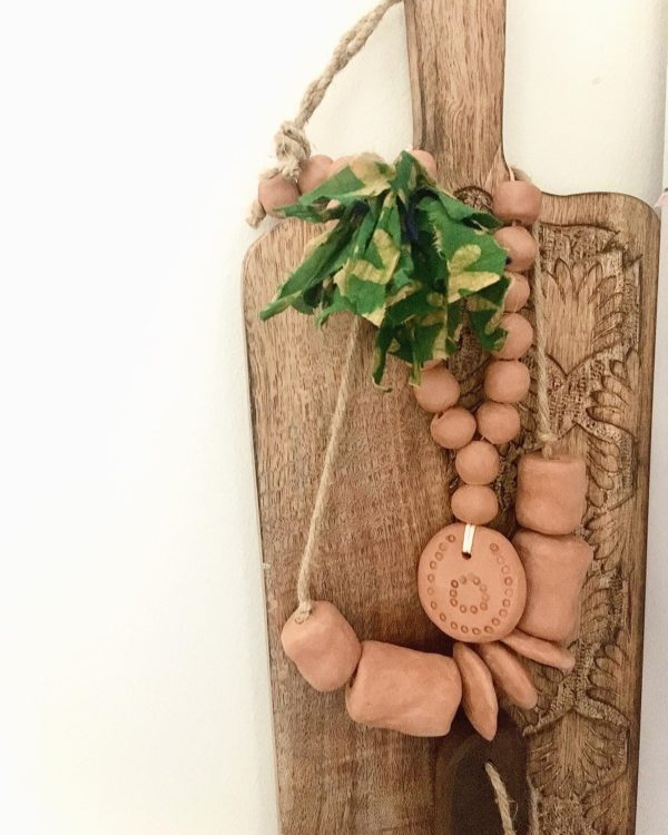minorca necklace with a wood plank